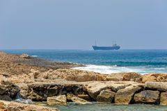 Sea coast and cargo ships. On horizon Stock Image