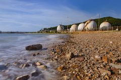 Sea coast and gas storage tank in heavy petrochemical industry e stock photos