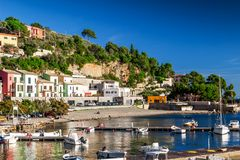 Sea coast with houses on the hill Stock Photo