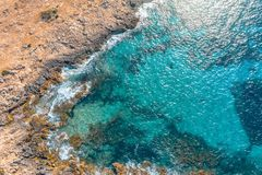 Sea coast on the island, aerial view from above top.  stock photography