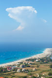 Sea coast and kiteboarders. Beautiful summer Lefkada coast beach and kiteboarders (Greece, Ionian Sea,  view from up). All people are not identifiable Stock Photography