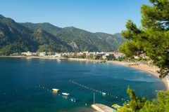 Sea coast line with beach, hotels and yachts shot Stock Photography