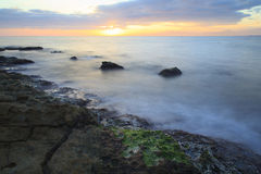 Sea coast in a long exposure shot, with blurred water Royalty Free Stock Images