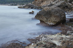 Sea coast in a long exposure shot, with blurred water Stock Image
