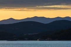 Sea coast and mountains after sunset, west coast of Sithonia, Greece Stock Photo