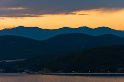 Sea coast and mountains after sunset, west coast of Sithonia, Greece Stock Photography