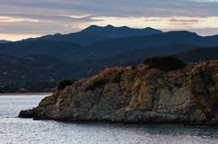 Sea coast and mountains after sunset, west coast of Sithonia, Greece Royalty Free Stock Photography