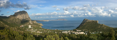 Sea coast with mountains and town Royalty Free Stock Images
