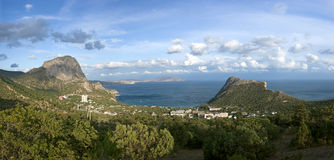 Sea coast with mountains and town Stock Images
