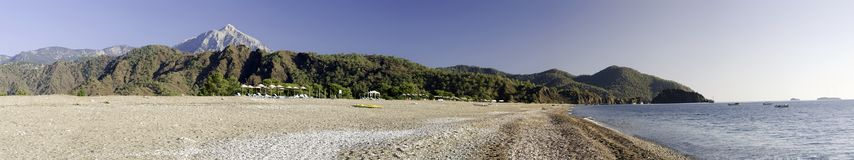 Sea coast panorama. Panoramic shot of a sea coast in South Turkey with hills and a grey rocky mountain in the background Stock Images