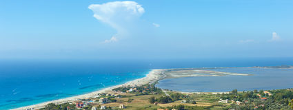 Sea coast panorama and kiteboarders. Beautiful summer Lefkada coast beach and kiteboarders (Greece, Ionian Sea,  view from up). All people are not identifiable Stock Photos