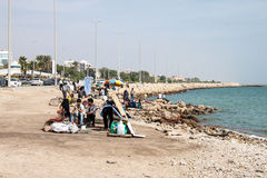 Sea coast with people smoking water pipes Stock Photo