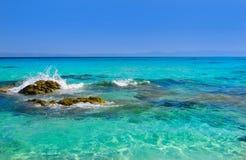 Sea coast under blue sky. Sea coast with rocks under blue sky Stock Image