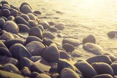 Sea coast with round sea stones Stock Photography