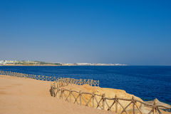 Sea coast. Sandy Beach in Egypt Royalty Free Stock Photos