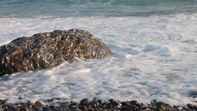 Sea coast scene with water and rocks stock video footage