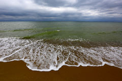 Sea coast at storm time Stock Images