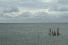 Sea and the coast on a stormy winter day, a seen from a beach in. Thailand Royalty Free Stock Photo