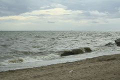 Sea and the coast on a stormy winter day, a seen from a beach in. Thailand Stock Photos