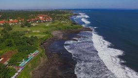 Aerial footage of sea coast near to Tanahlot temple on the Bali Island stock video footage
