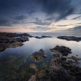 Sea coast at sunset Stock Photography