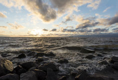 Sea coast in sunset, seascape, water among the rocks, waves brea Royalty Free Stock Photo