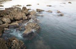 The sea coast with a surf Stock Photos