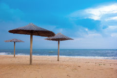 Sea coast with thatched umbrellas Stock Photo