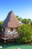 The sea coast with the traditional house in Xcaret park near Cozumel, Mexico. Landscape in a sunny day Royalty Free Stock Photography