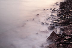 Sea coast wave and rock Stock Images