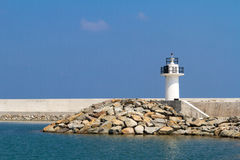 Sea Coast with White Lighthouse Stock Image