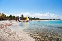 Sea coast - white sand, bathing people, sailing vessels, Stock Photo
