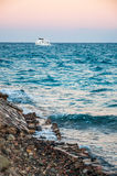 Sea coast and the white yacht. Hurghada, Egypt. Stock Images