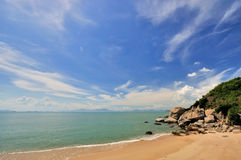 Sea coast with wide sky. Blue sky and white cloud by sea coast, shown as wide sea coast landscape Stock Photo