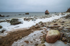 Sea coast in winter cloudy weather Stock Photography