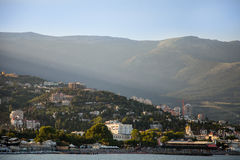 Sea coast of Yalta in beams of setting sun Stock Photography