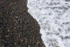 Sea coastline. Pebbles and water Stock Photo