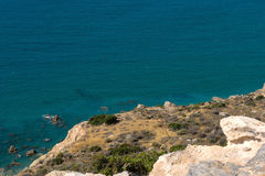Sea and coastline view from a rocky height Royalty Free Stock Photo