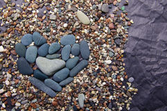 Sea color stones in the form of heart Royalty Free Stock Photo