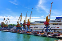 Sea commercial port. Unloading cargo stock image