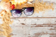 Sea concept composition with sand and eyeglasses Royalty Free Stock Photo