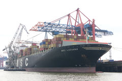 Sea container ship in Hamburg. The picture shows huge ocean ship on loading in the port of Hamburg Stock Photo