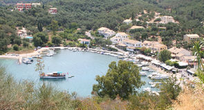 By the Sea, Corfu, Greece. Sheltered bay of Agios Stafanos with boats stock images