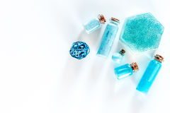 Sea cosmetics. Sea salt, blue clay and lotion on white background top view copyspace. Sea cosmetics. Sea salt, blue clay and lotion on white background top view Royalty Free Stock Image