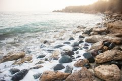 Sea cost with stones in Paphos district in Cyprus stock images