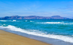 Sea cost with waves and sand, Crete, Greece Stock Photography