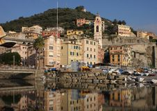 A sea country that is reflected in the waters of the gulf. The village of Sori, the Ligurian Riviera di Levante, is reflected in the waters of its beautiful Royalty Free Stock Photos