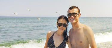 Sea couple happy sunny Stock Image