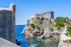 Sea cove and city wall tower under Fort Lovrijenac in Dubrovnik, Royalty Free Stock Photos