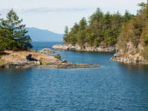 Sea cove of remote rocky coast Stock Images
